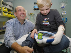Associate Professor Sam Bucolo with a young burns patient using Ditto.